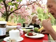 paul is enjoying his breakfast in the garden with